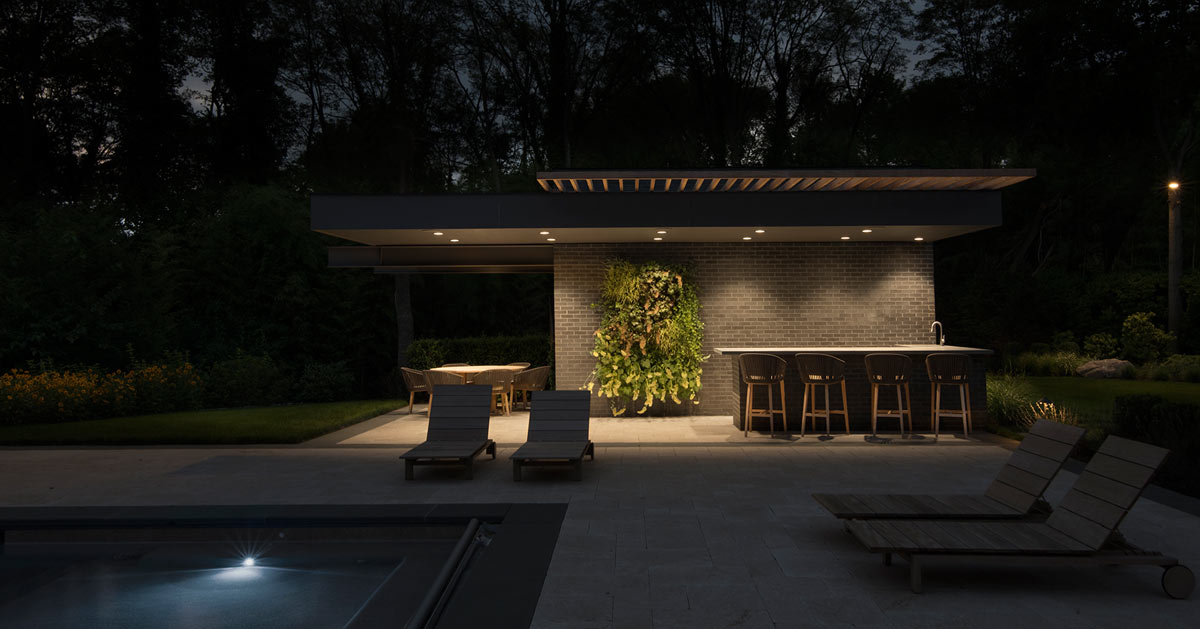 Black Brick Modern Pool House Cabana Lighting At Night