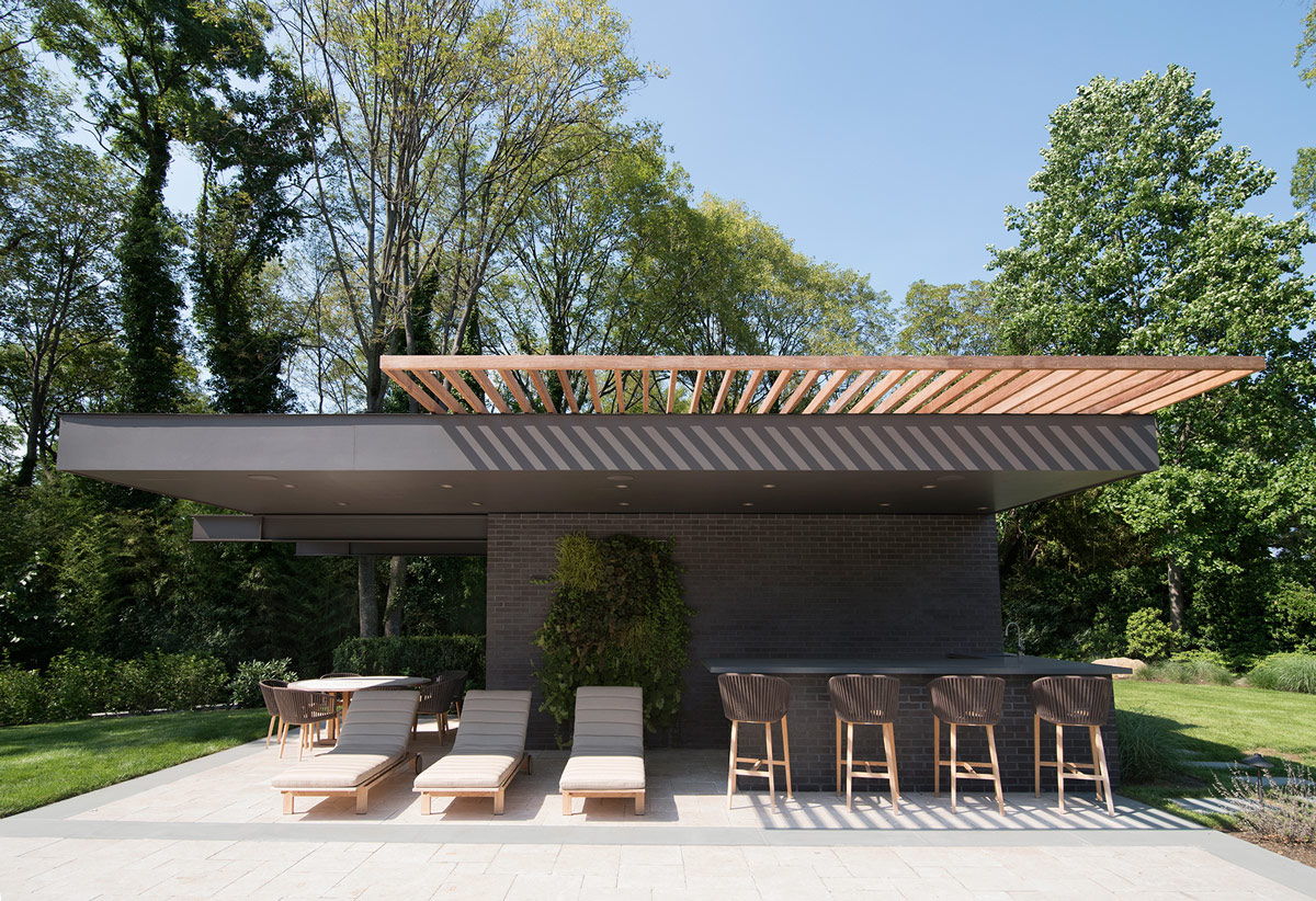 Modern Pool House with Cantilevered Outdoor Bar
