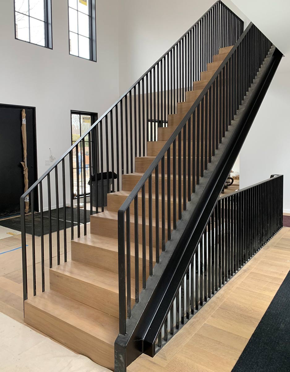 custom Black Steel and Light wood modern stair design and home interiors