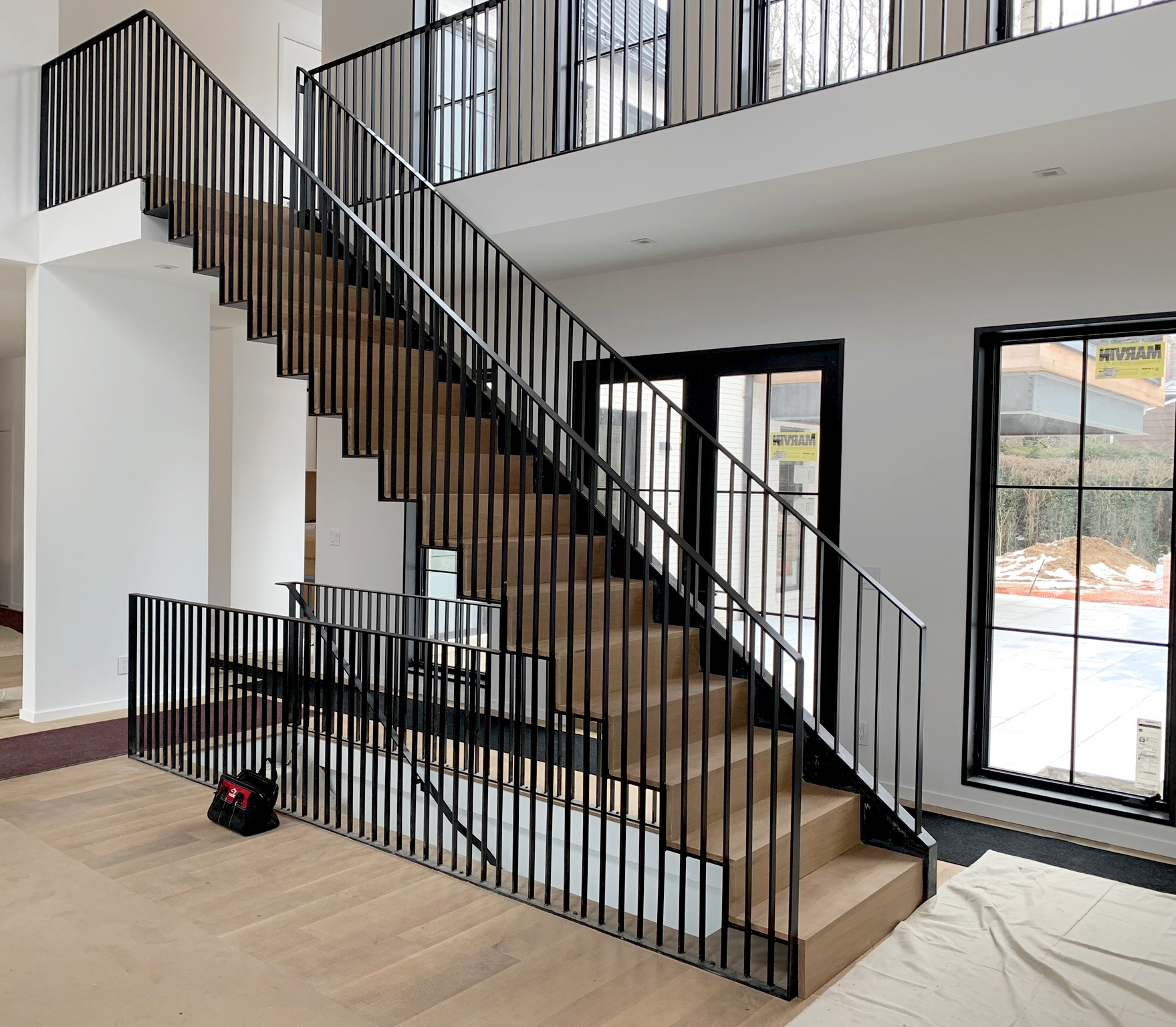 Long Island Modern Interior Design Custom Steel Staircase Black and White Home Design Under Construction