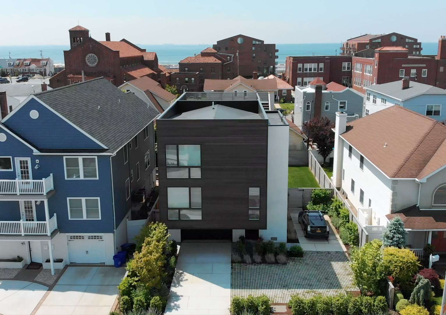 Long Beach NY Sustainable Black Modern Home with Roof Deck and Solar Panels